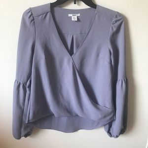 Lilac color, long sleeve blouse.